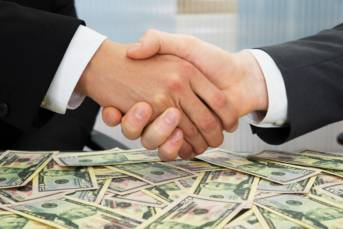 http://www.dreamstime.com/royalty-free-stock-images-businesspeople-shaking-hand-close-up-over-heap-banknotes-image54969399